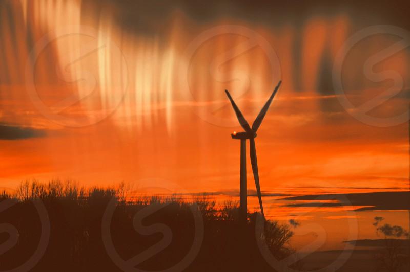 Windmill aurora northern lights wind turbine alternative enrgy economy silhouette nature sunset sunrise energy efficiency technology harmony windmill silhouette orange vibrant photo