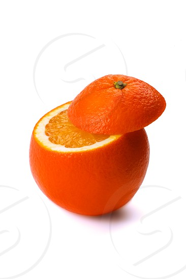 fresh ripe orange cutted on top isolated on white background photo
