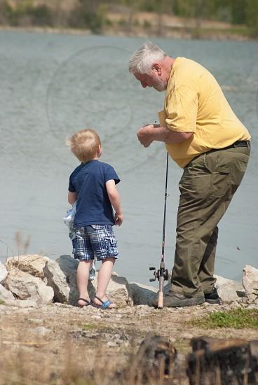 Teaching his grandson to fish!  photo
