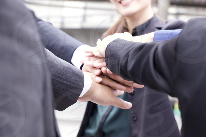 Hands of business people are working together photo