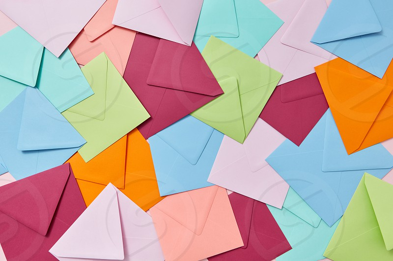 Creative background from handcraft colored blank envelopes and letters. photo