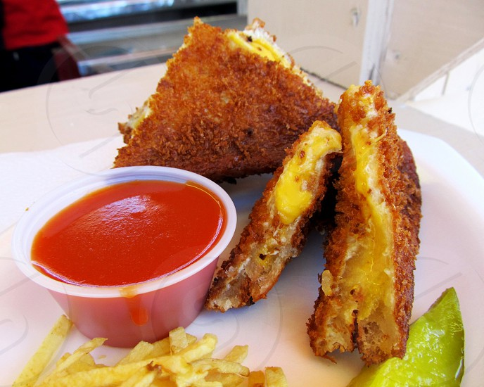 Deep fried grilled cheese sandwich with tomato soup dip photo