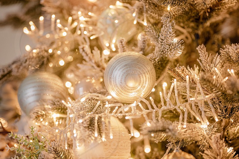Luxurious festive decor of a Christmas tree with garlands for an elegant holiday. Background of a happy new year and the atmosphere of comfort. photo