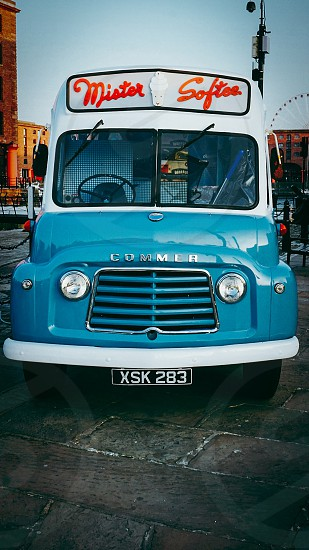 blue and white commer bus photo