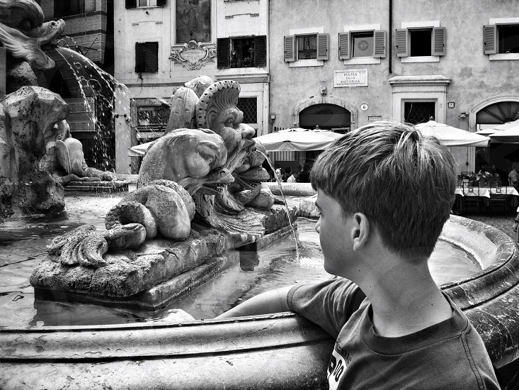 Young boy at fountain near Pantheon in Rome in black & white photo