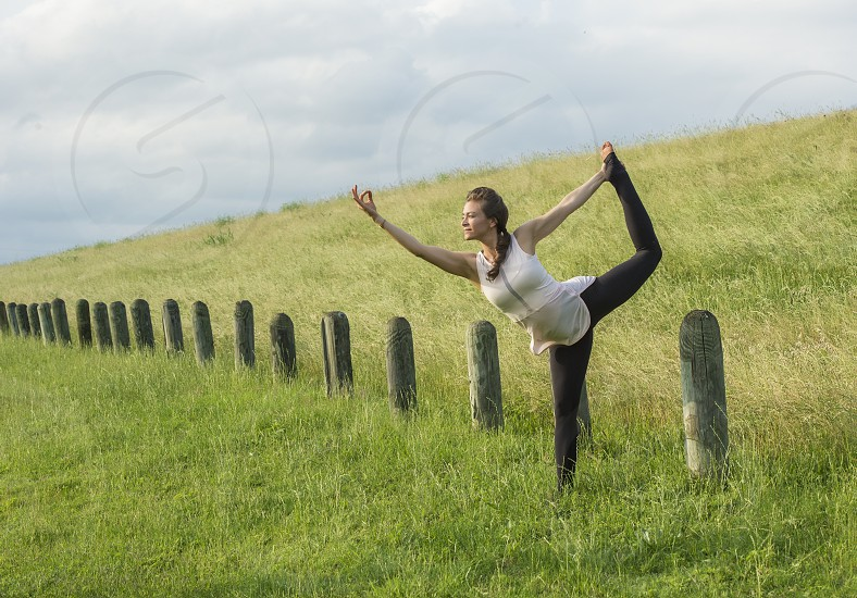 Image of a girl doing yoga outside photo