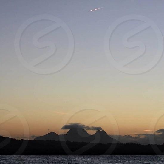 tall mountain on island photo