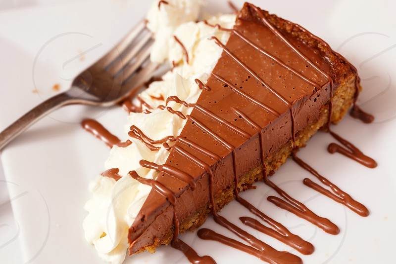 Slice of Chocolate Pie with Whipped Cream photo
