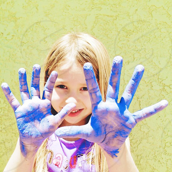 girl with painted hands photo