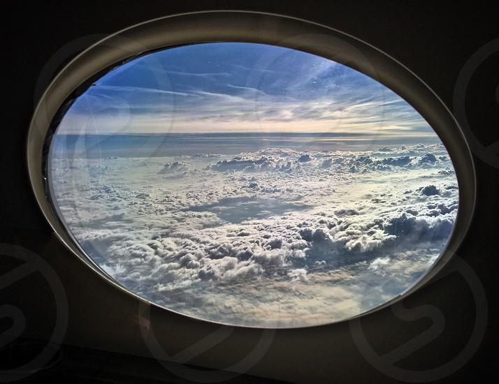 Skies above clouds below photo