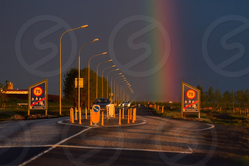 City limits of Hvolsvöllur Iceland in sunset light with rainbow on the background.  photo