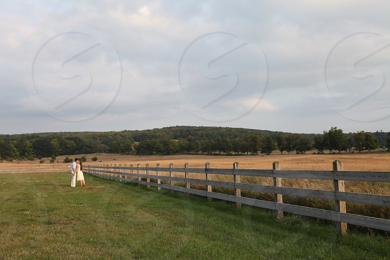 couple kissing in farm ranch photo