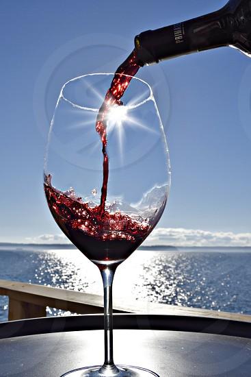 Sunshine pouring wine photo