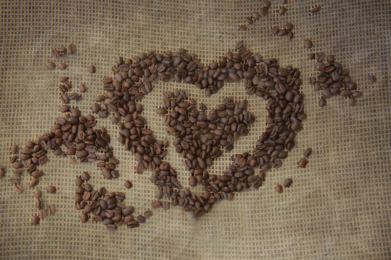 Coffee beans used to make a heart photo