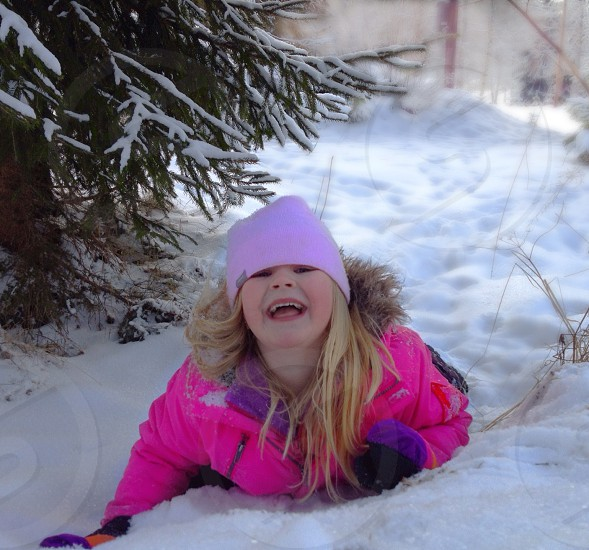 Laughing snow winter young girl happy child  photo