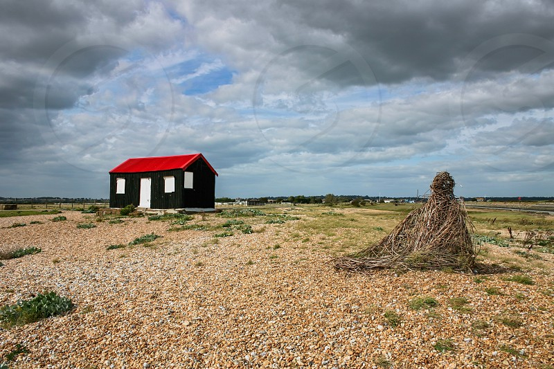 Old Corrugated Shack on the Beach at Rye in East Sussex photo
