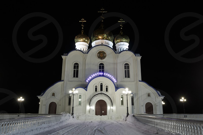 PETROPAVLOVSK KAMCHATKA RUSSIA - JAN 6 2018: Night architectural illumination of building of Holy Trinity Orthodox Cathedral of Petropavlovsk Kamchatka Peninsula Diocese of Russian Orthodox Church photo