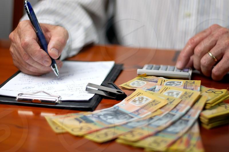 Man counts money Australian dollars photo