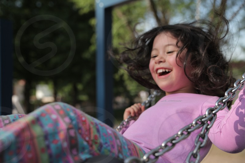 swing smile girl laughing child swingset playground photo