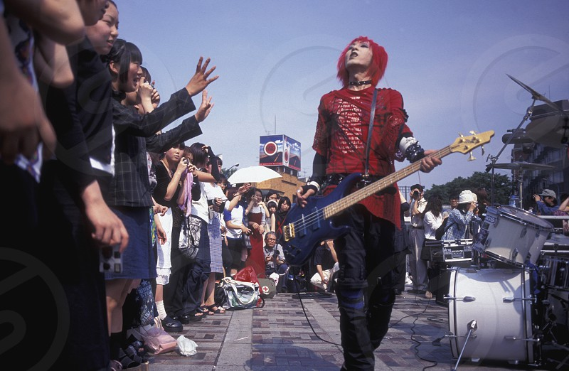 a Japanese Youth Punk Band plays on a square in the City of Tokyo in Japan in Asia photo