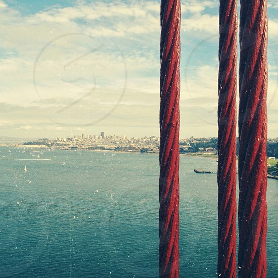 red metal cable and blue ocean photo