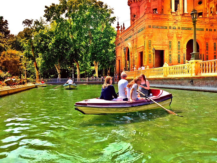 Spain Sevilla holiday summer sunny river water lake rowing boat trees building people vacation family day nature natural iphone6 landscape  photo