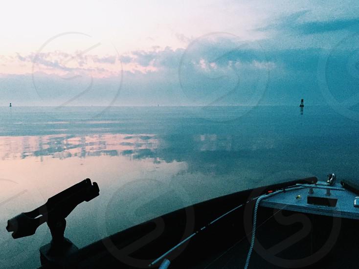 Sea ocean fishing boat morning sunrise photo