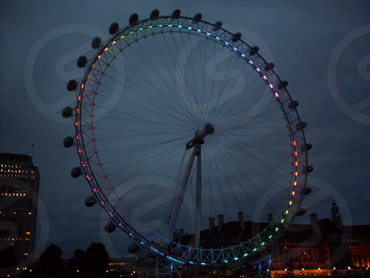 ferris wheel dusk night sky London England photo