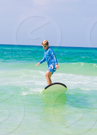 Surfing ocean lifestyle beach sports outdoors environment photo