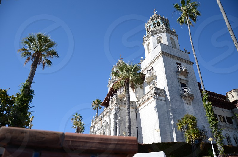 white concrete chapel under blue sky during daytime photo