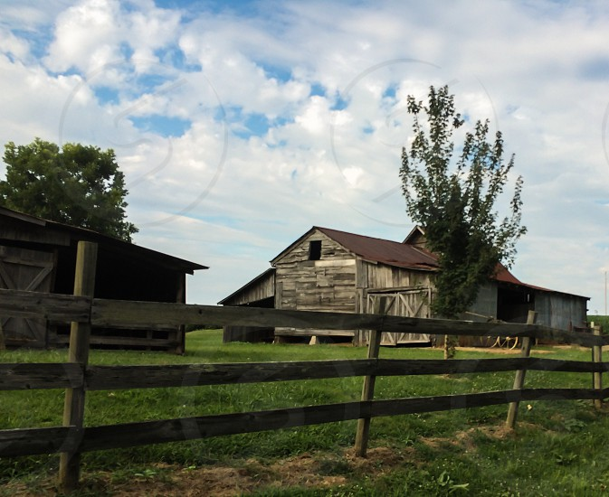 rustic farm houses and three post fence photo
