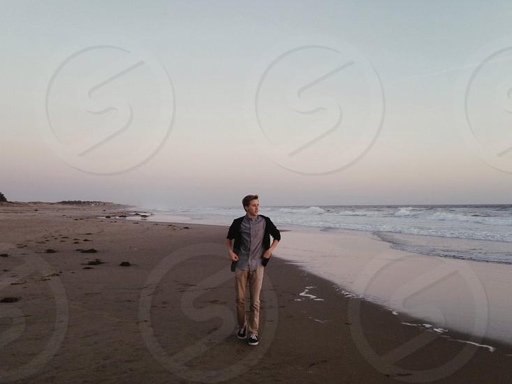 man on seashore photo