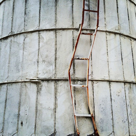 ladder leaning on wall photo