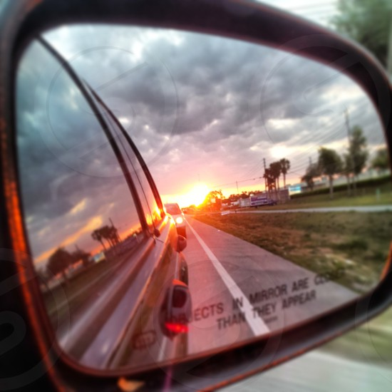 sunset car rear view mirror photo