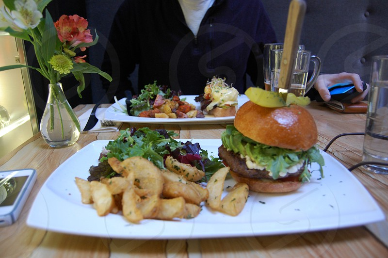 burger and vegetables on plate photo