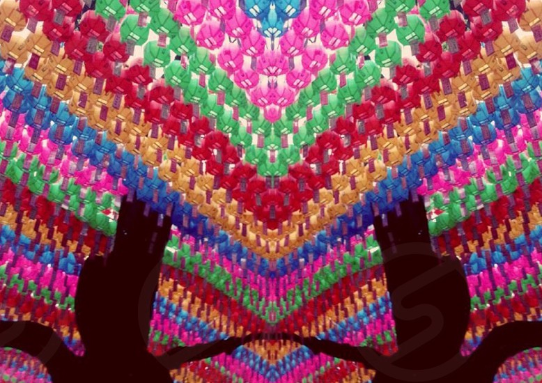 pink red green and blue knitted textile photo