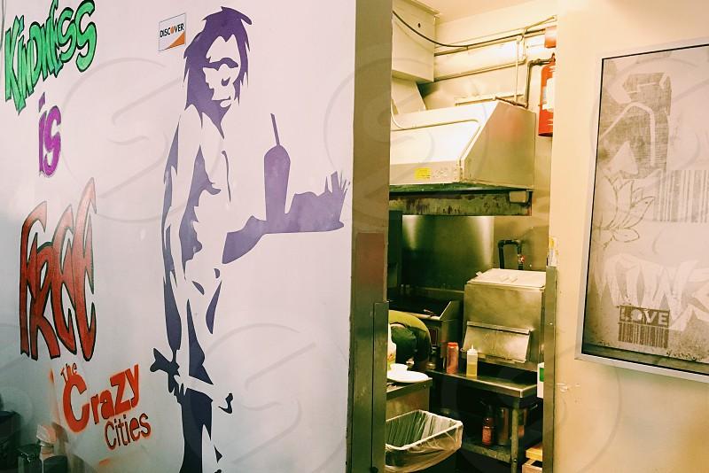 Kitchen restaurant caveman diner kindness takeout Neanderthal graffiti art photo