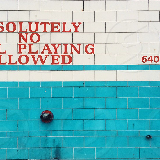 absolutely no playing allowed written on wall photo