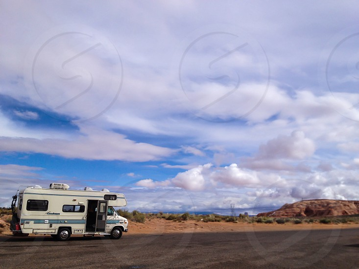 white rv on road photo