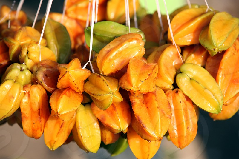 starfruits at the Market in the city of Dili in the east of East Timor in southeastasia. photo
