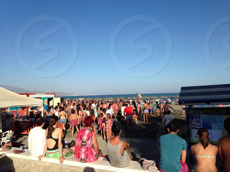 The people of Spain have a dance.. On the beach.... As you do..  photo