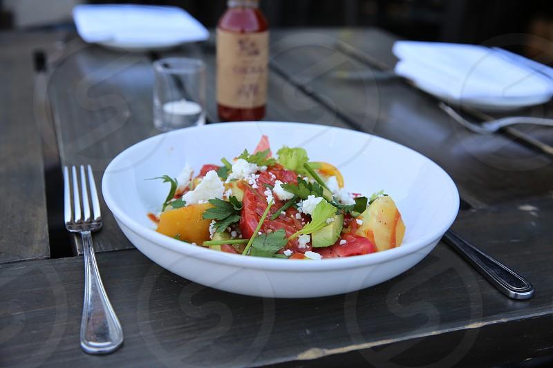 veggie salad on a white ceramic round bowl photo
