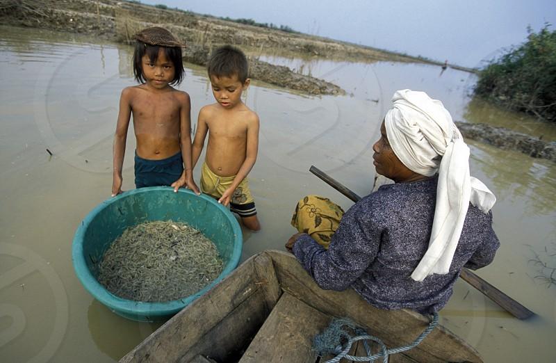 Der Alltag auf dem Tonle Sap Lake bei Siem Reap und der Ruinenstadt von Angkor in Kambotscha in Suedost Asien. photo