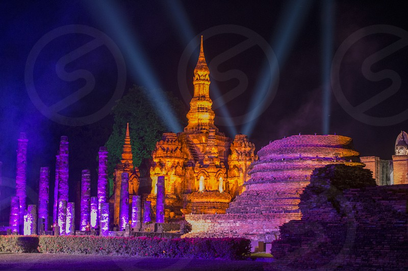 a light show at the Wat Mahathat Temple on the Loy Krathong Festival in the Historical Park in Sukhothai in the Provinz Sukhothai in Thailand.   Thailand Sukhothai November 2018 photo