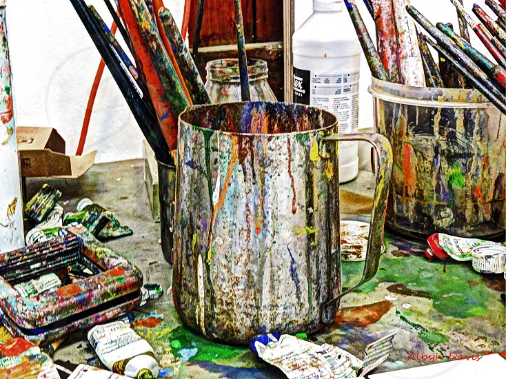 artist's workbench paint cans and brushes photo
