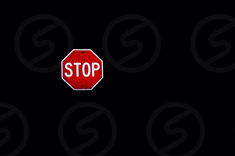 stop sign black background photo