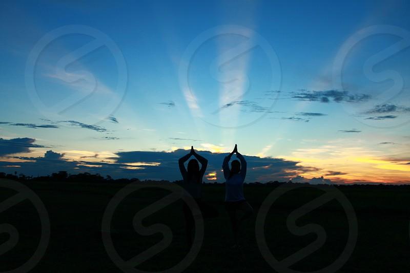 Sunset yoga meditation photo