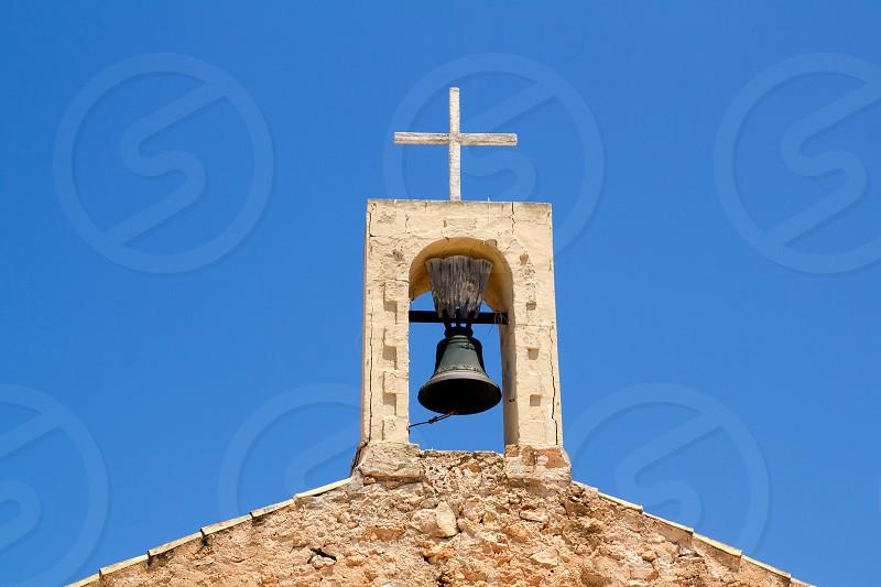 Sant Ferran church stone belfry detail in Formentera island of Spain photo