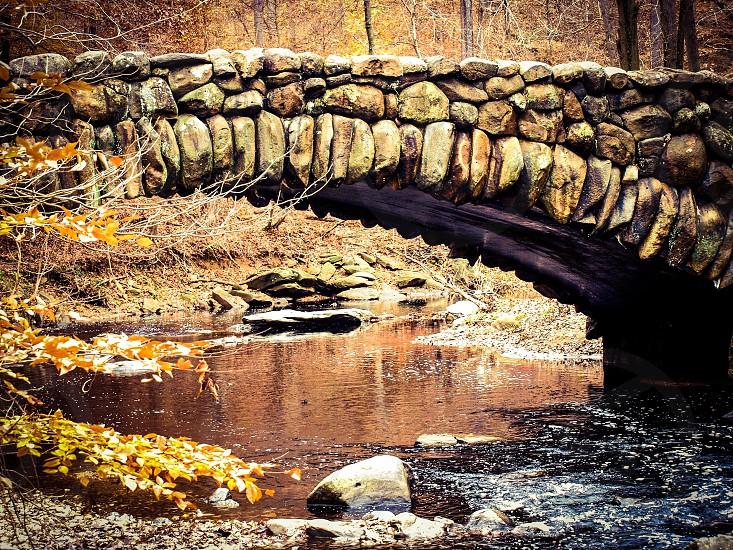 stone bridge over water photo