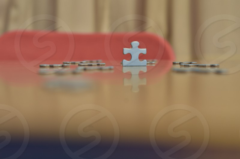 white puzzle piece on top of the table photo